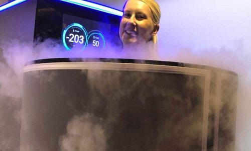 girl getting whole body cryotherapy in a greenville cryochamber
